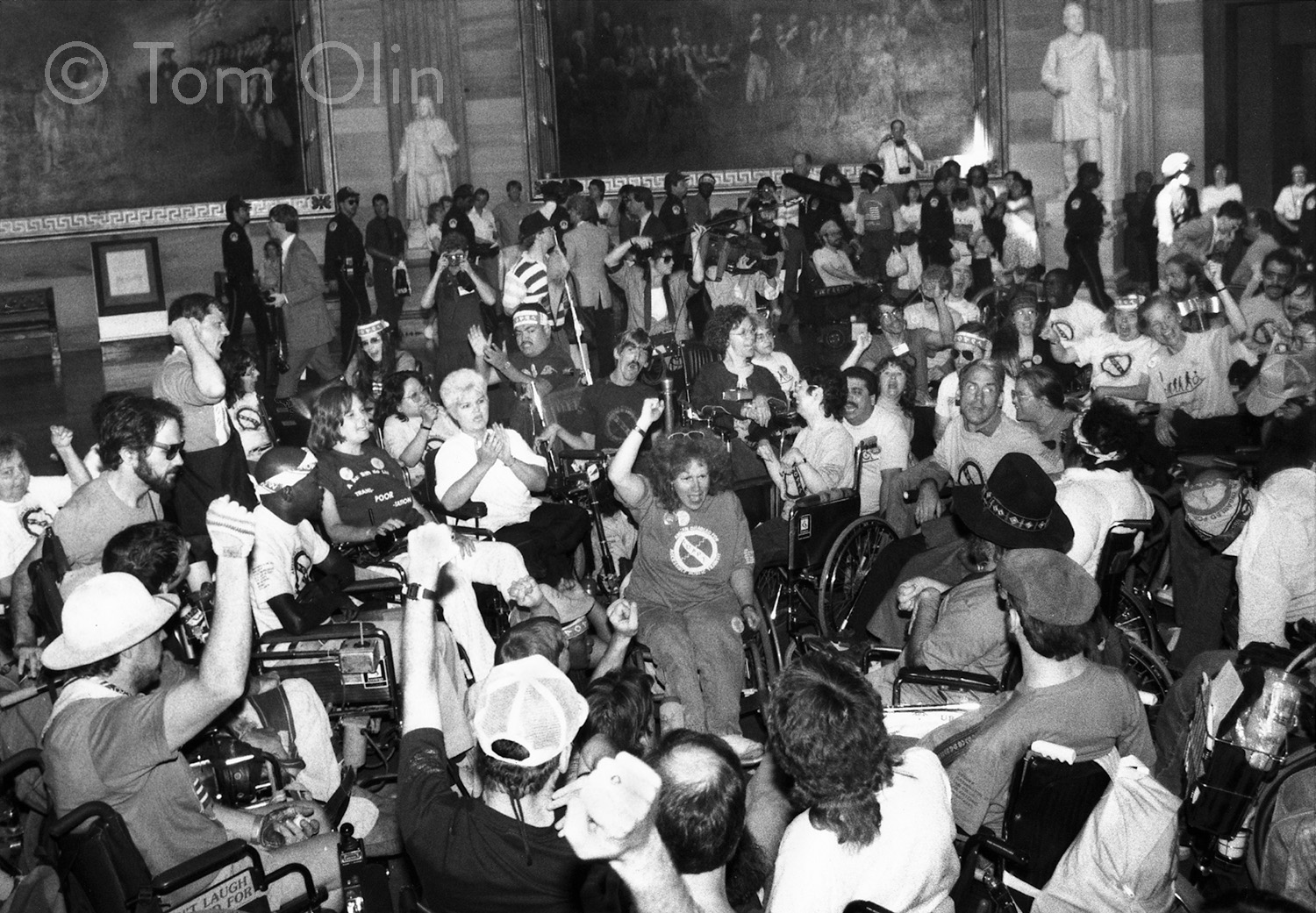 Back and white photo of hunderds of protesters in the Rotunda of the U.S. Capitol