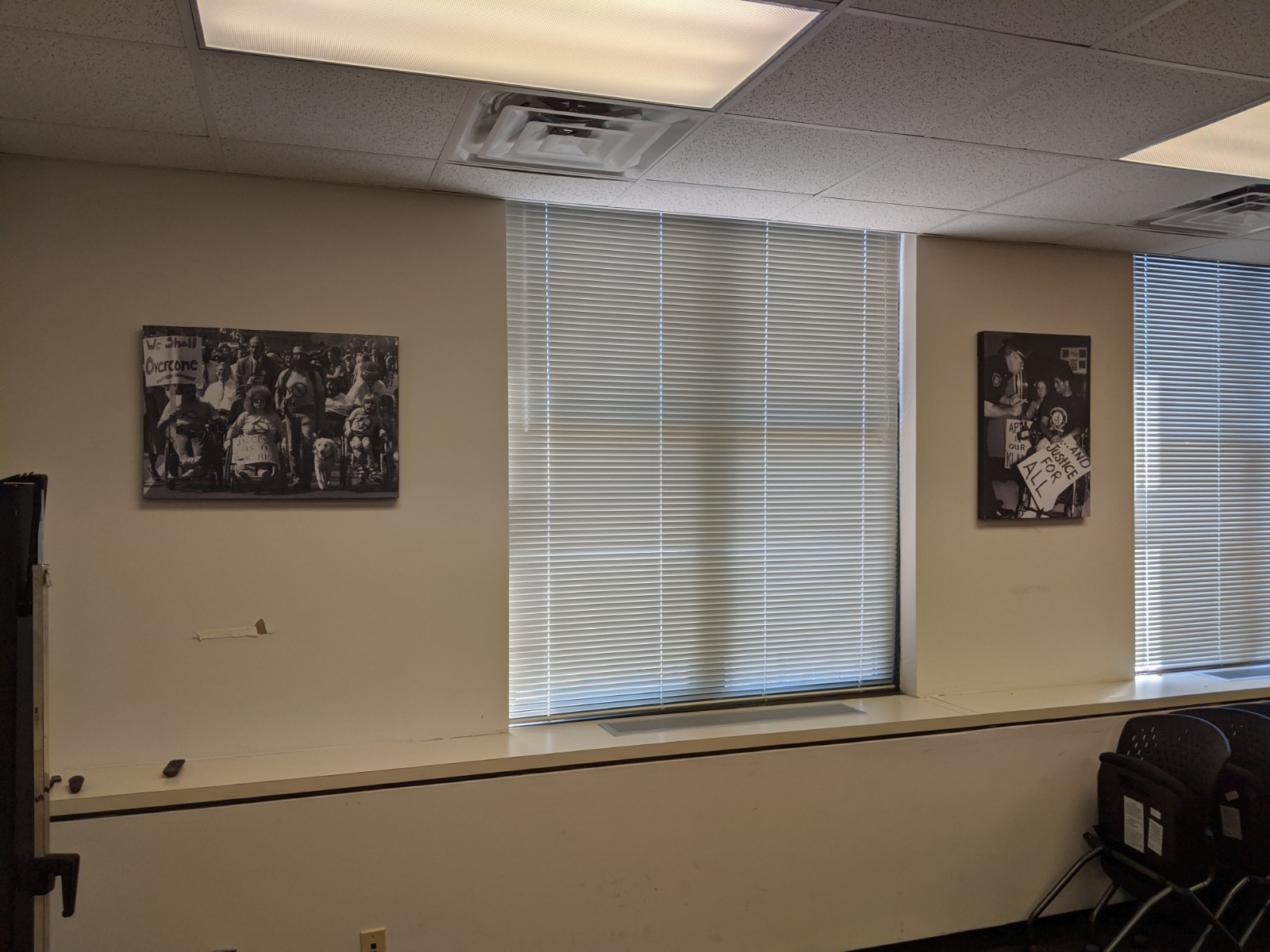 A meeting room with Tom Olin's black and white photos hung on the wall